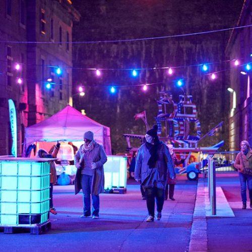 Street view of pedestrians walking around Illuminate