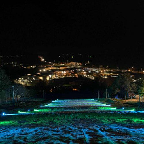 Exterior Ski Slop cross-lighting to advertise Illuminate