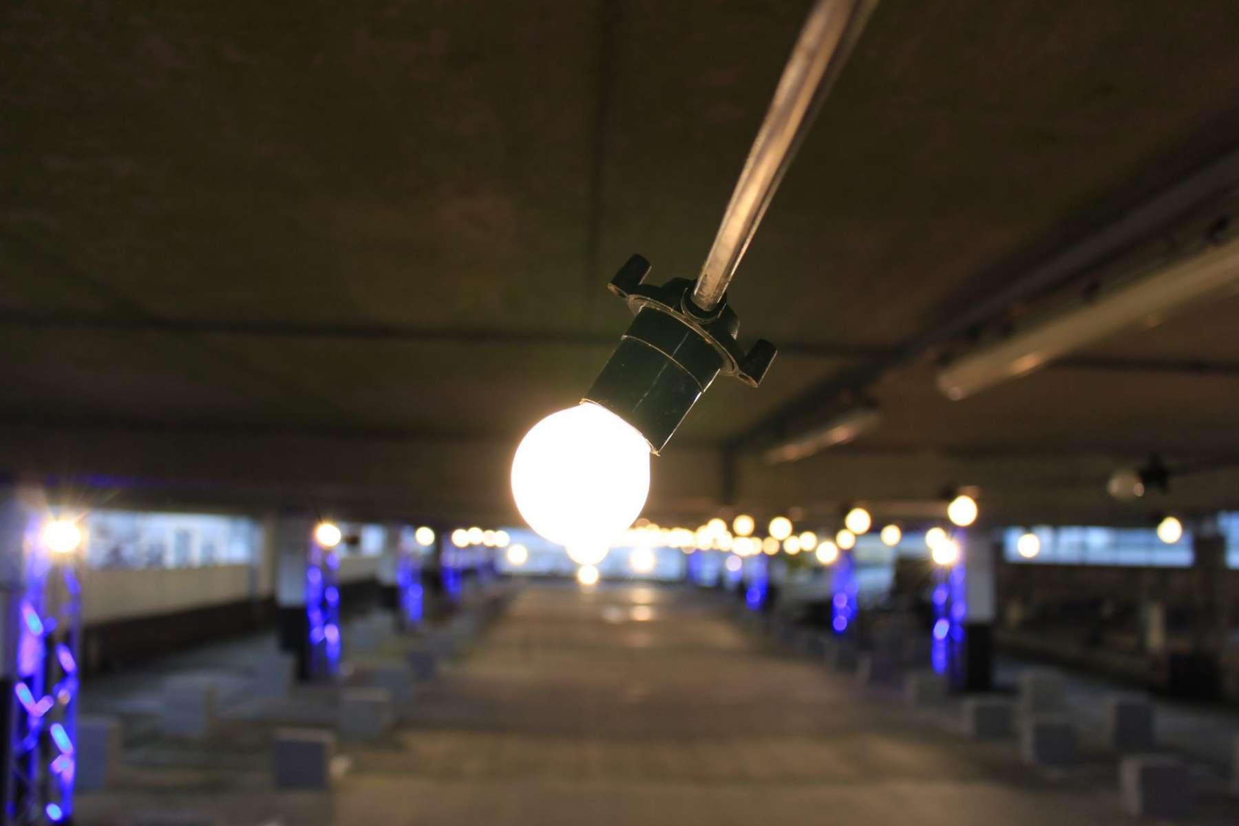 closeup of a festoon lightbulb at a fashion show