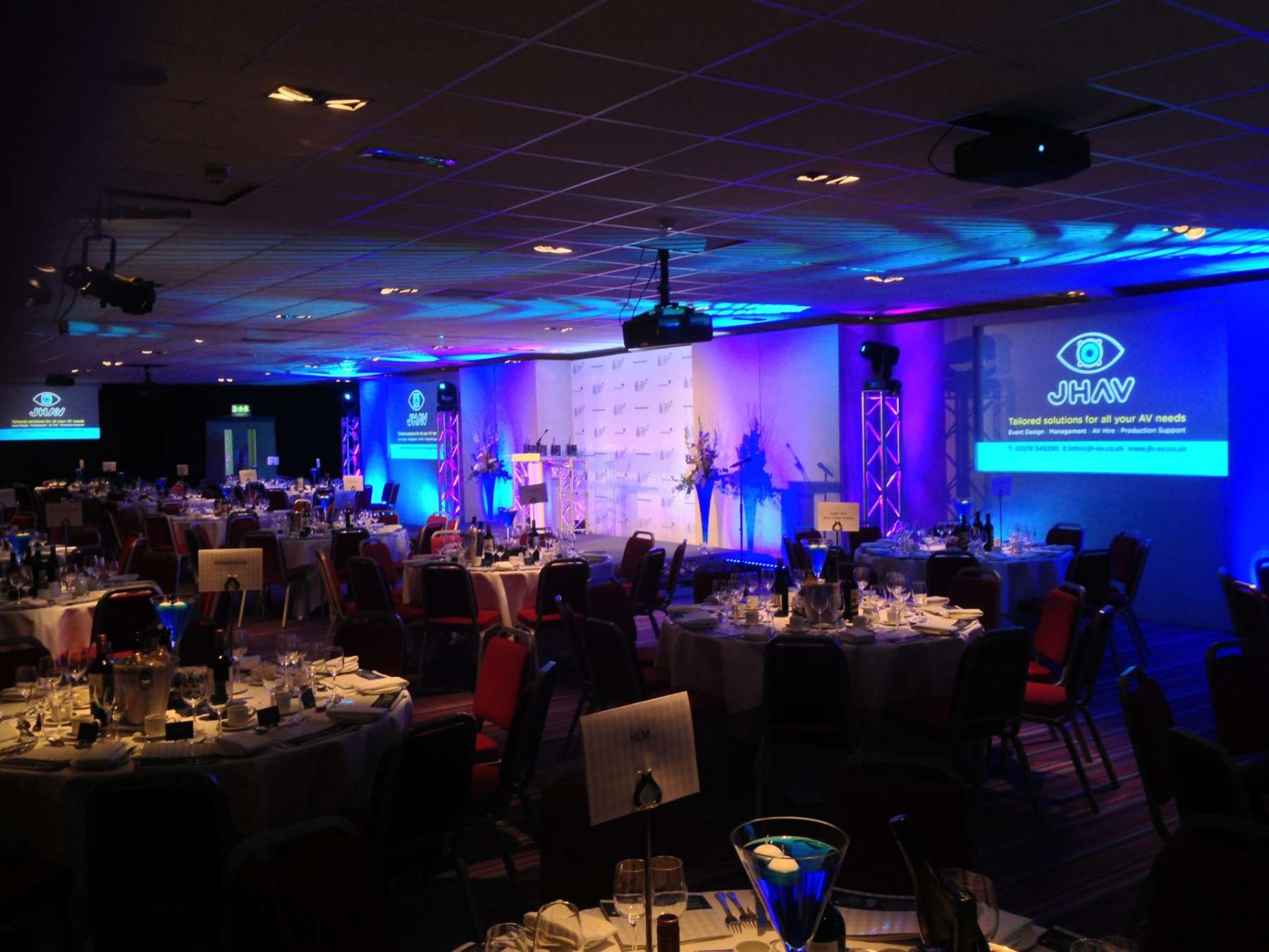 corporate event setup with blue uplighting