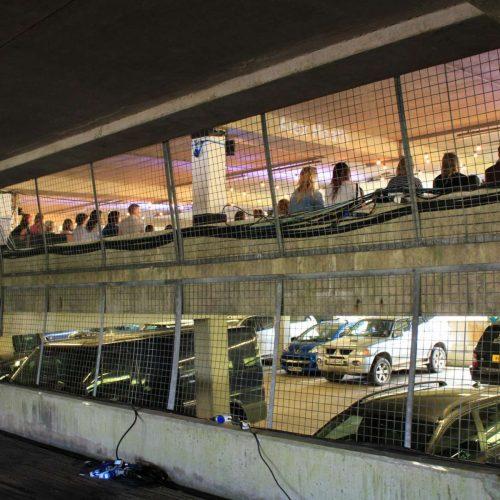 Exterior shot of car park fashion show