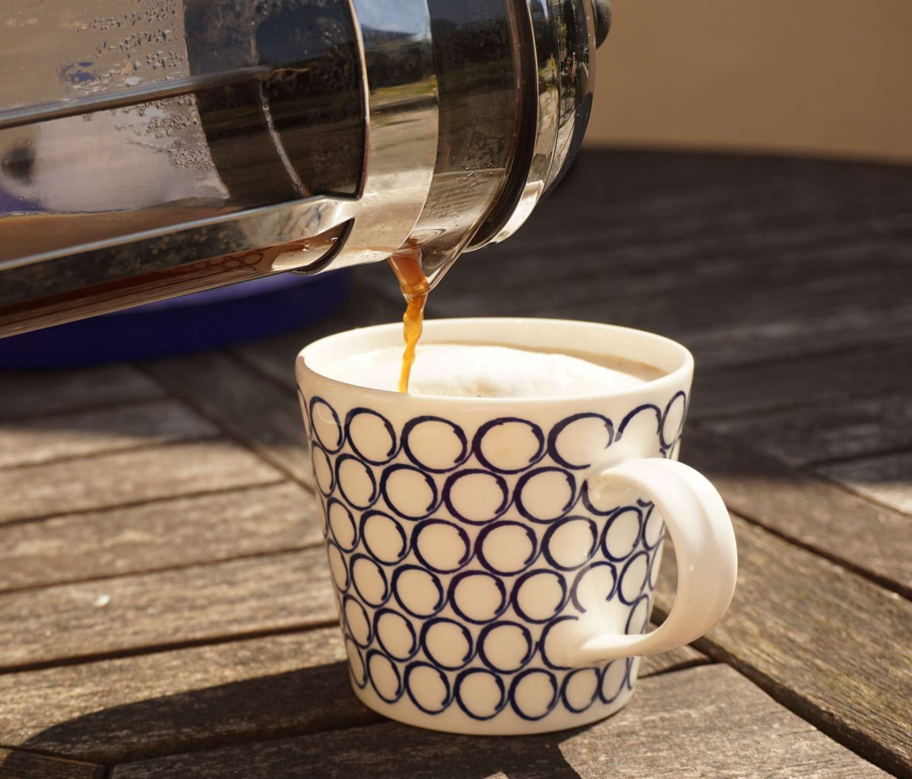 Pouring coffee from a french press